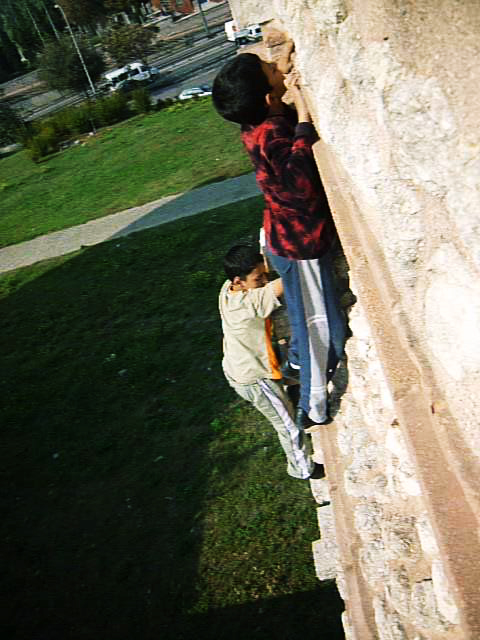 Two boys climb the wall: inspired by Adam who initiated a wall climb