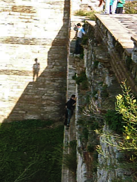 Group of boys take an improvised descent down the outside of the Byzantine wall