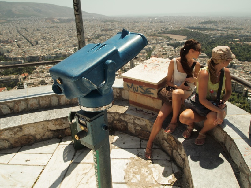 Athens from the highest point, a viewpoint, everyone looking at the Acropolis