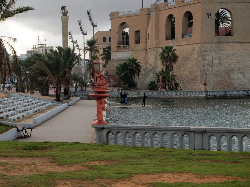 Posing Men next to Medina